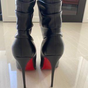 Black Christian Louboutin boots.
